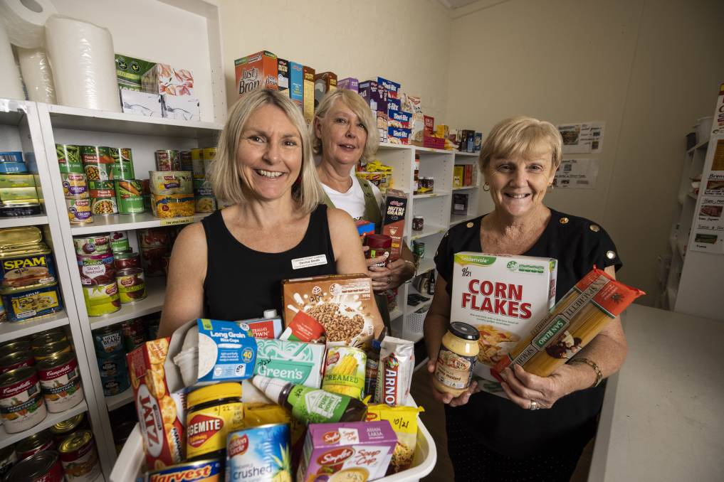 Davina Smith (co-ordinator) and volunteers Debra and Chris from Turning Point Camden are calling for the community to donate non-perishables for crisis support. Picture: Simon Bennett
