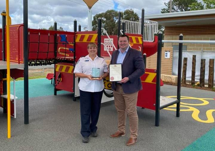 Worthy: Kim Hill receives her award from Wollondilly MP Nathaniel Smith. Picture: Nathaniel Smith/Facebook