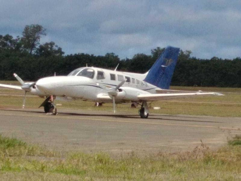 Two men charged over a plane load of cocaine that crashed in PNG have been denied bail.